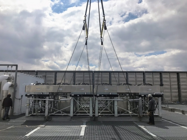 crane_setting_down_rooftop_units_telx_digital_realty_HVAC_nj_Crane